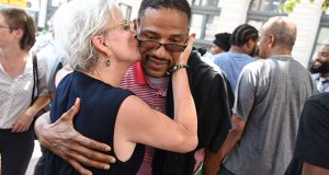 Defense attorney Nancy Forster embraces client Jerome Johnson after his release from prison outside Baltimore City Circuit Court. Johnson spent the last 30 of his 50 years behind bars after a 1988 murder conviction. He was exonerated in 2018. ( Maximilian Franz)
