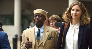 Former state Sen. Nathaniel Oaks, left, leaves the Edward A. Garmatz U.S. Courthouse in Baltimore with attorneys, including Federal Public Defender Rebecca Talbott, right, on Tuesday, after he was sentenced to 42 months in prison. (The Daily Record / Maximilian Franz)