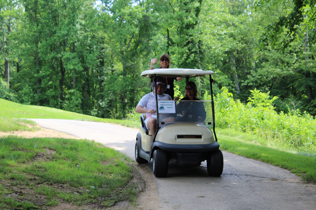 From left, The Baltimore Station's Volunteer Service Manager Todd Troester, Clinical Director Arlene Hackbarth and Director of Development and Communications Kim Callari take a ride around the Mountain Branch Golf Club. (Photo by Giovanni Medoro, MMHA)