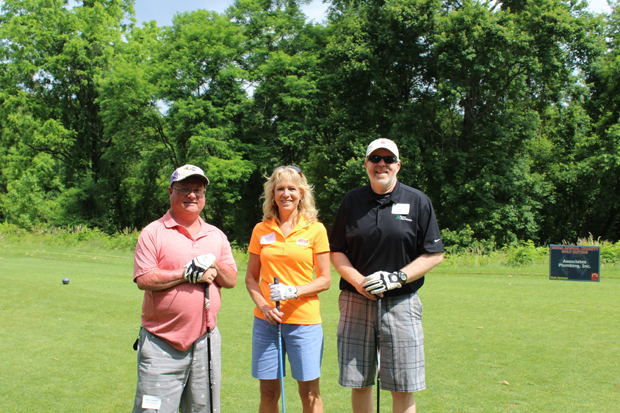From left, Mike Crampton, director of maintenance services with Habitat America LLC; Donna Boesel, CEO of Walter Electric; and Mike Stark, regional property manager with Home Properties, enjoy their time on the course. (Photo by Giovanni Medoro, MMHA)