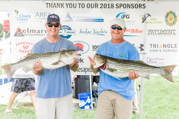 Todd Holtner, left, and Butch Pearson show off their catches during the third annual Casey Cares Rockfish Tournament. (Photo by Ceremony Photography)