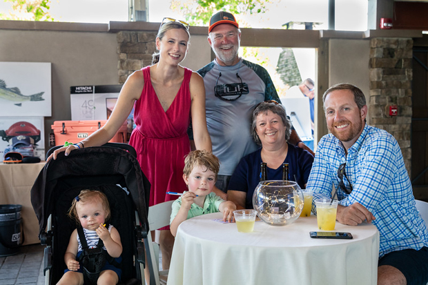 From left, Libby Cathell, Katie Cathell, Jack Cathell, Danny Cathell, Georgina Cathell and Casey Cares Board member Dan Cathell enjoy the festivities after a day of fishing. (Photo by Yumi Okomoto Photography)