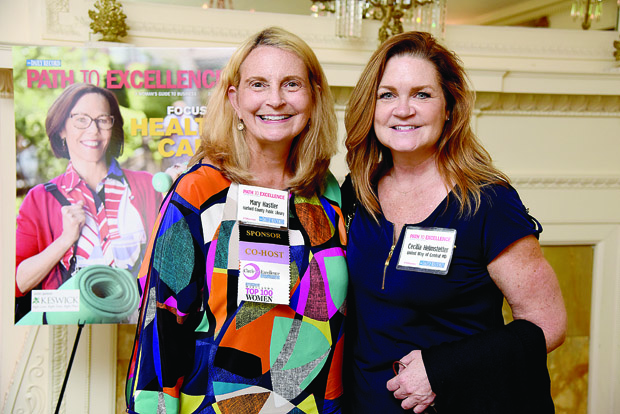 Harford County Public Library was the sponsor of the July 17 Path to Excellence networking event in Bel Air. Mary Hastler, left, CEO of Harford County Public Library, was a co-host and posed while speaking with Cecilia Helmstetter, the director of development with the United Way of Central Maryland. (Photo by Maximilian Franz / The Daily Record)