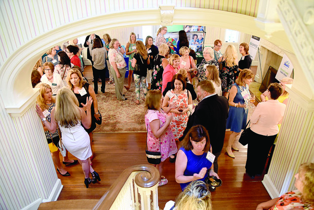 A crowd of more than 100 women gathered in the main room at Liriodendron Mansion for The Daily Record's Path to Excellence networking series. (Photo by Maximilian Franz / The Daily Record)