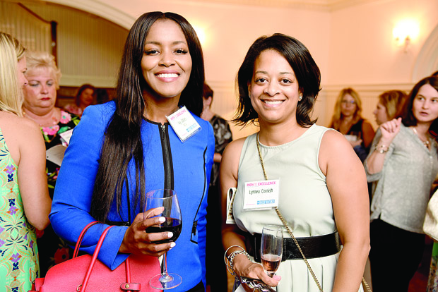 Ivy Gales, left, community market leader with SECU, and Lynnea Cornish, senior director of elementary programming and support with Concentric, enjoy the networking event. (Photo by Maximilian Franz / The Daily Record)