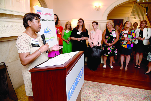 Rosalyn Stewart, a volunteer and external relations manager with Keswick, welcomes guests to The Daily Record's Path to Excellence networking series at the Liriodendron Mansion in Bel Air. Keswick is a Path to Excellence networking series sponsor. (Photo by Maximilian Franz / The Daily Record)