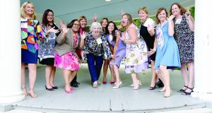 Former Top 100 Women and Leading Women honorees who attended the event have fun during a group photo at the Liriodendron Mansion in Bel Air. (Photo by Maximilian Franz / The Daily Record)