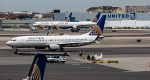 United Airlines airplanes sit outside the company's hangar in Newark, N.J. The airline has denied allegations by the Equal Employment Opportunity Commission that it did not protect a female flight attendant from years of harassment by a male colleague. (Bloomberg/Timothy Fadek)