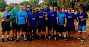 Umpire John Kowatch, far left, poses with The Great Americans, champions of the Lawyers League softball. From left: Tim Buckelew, Eric Schloss, Cliff Robinson, Bob Miller,  Tony Thomas, Dave Luby, David Silverman, Jon Herbst, Matt Woods, Brendan Murphy, Charles Arcodia, Matt Rogers, Brandon Mourges, Nick Bonadio and Nate Barker. (Submitted photo)
