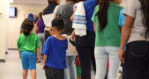 In this Aug. 9, photo, provided by U.S. Immigration and Customs Enforcement, mothers and their children stand in line at South Texas Family Residential Center in Dilley, Texas. With new information seemingly every day about the Trump administration's immigration policies, the immigration law clinics at Maryland's two law schools have been busy. (Charles Reed/U.S. Immigration and Customs Enforcement via AP)