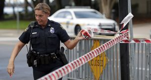 A Jacksonville police officer blocks off an area Monday, Aug. 27, 2018, near the scene of a fatal shooting at The Jacksonville Landing on Sunday in Jacksonville, Fla. A gunman opened fire at a video game tournament killing multiple people and then fatally shooting himself in a rampage that wounded several others. (AP Photo/John Raoux)