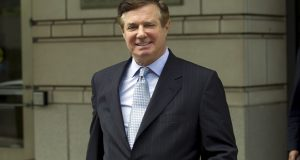 FILE - In this May 23, 2018, file photo, Paul Manafort, President Donald Trump's former campaign chairman, leaves the Federal District Court after a hearing, in Washington. As jurors weigh Manafort's fate in a sprawling financial fraud case taking place in Alexandria, Va., Manafort still has another, separate trial looming in the nation's capital. Neither case involves allegations of Russian election interference or possible coordination by the Trump campaign, which are at the heart of Mueller's larger investigation. But President Donald Trump has expressed a keen interest in Manafort's fate as he seeks to publicly undermine Mueller's probe. (AP Photo/Jose Luis Magana, File)