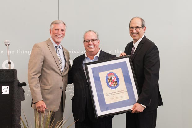 From left, Charles County Commissioner Peter Murphy presents Recovery Center of America founder and CEO Brian O'Neill and Maryland Center for Addiction Treatment CEO Adam Brickner with the county seal during the new treatment center's grand-opening celebration in Waldorf. (Photo by Bill Cassidy, Recovery Centers of America)