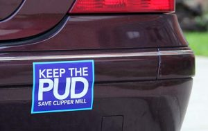 A resident's car is parked Monday outside the Millrace condos, adorned with a bumper sticker opposing a proposal by Clipper Mill's owner to repeal the area's zoning overlay, called a Planned Unit Development. If the PUD is repealed, the area would be zoned for transit-oriented development easing required parking restrictions for building. (The Daily Record / Adam Bednar)