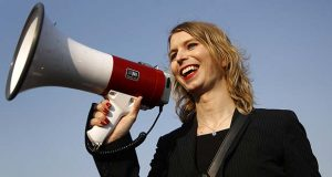 FILE - In this April 18, 2018, file photo, Chelsea Manning addresses participants at an anti-fracking rally in Baltimore. Convicted classified document leaker Chelsea Manning will not be allowed to enter Australia for a speaking tour scheduled to start Sunday, Sept. 2, 2018. (AP Photo/Patrick Semansky, File)