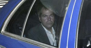 FILE - In this Nov. 18, 2003 file photo, John Hinckley Jr. arrives at U.S. District Court in Washington. The man who tried to assassinate President Ronald Reagan will soon undergo a new round of psychological tests. A federal judge on Friday, Aug. 17, 2018, authorized a doctor to determine Hinckley Jr.'s risk to society. He left a mental hospital to live with his mother nearly two years ago. The doctor's assessment will help a court decide if Hinckley can live under fewer of the restrictions that were imposed upon his release. Hinckley has been living in a gated community in Williamsburg, Va.  (AP Photo/Evan Vucci, File)