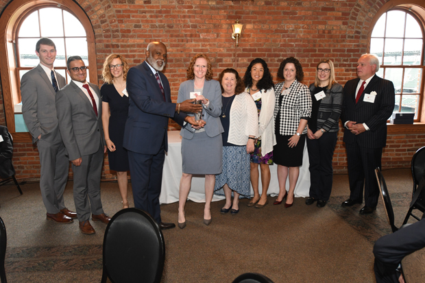 Maryland Legal Aid Executive Director Wilhelm H. Joseph, Jr. Esq., fourth from left, presents the Pro Bono Law Firm of the Year to attorneys with Ballard Spahr during the 21st annual Equal Justice Awards Breakfast. (Photo by Eric Stocklin)