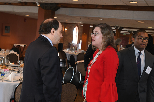 Mitch Murvis and Amy Petkovsek have a conversation during the 21st annual Equal Justice Awards Breakfast. Coates was the keynote speaker for the event. (Photo by Eric Stocklin)
