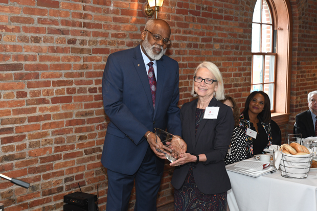 Maryland Legal Aid Executive Director Wilhelm H. Joseph, Jr., Esq. presents Paula Miller, the director of the Baltimore County Public Library, with a Partners for Justice Award during the 21st annual Equal Justice Awards Breakfast. (Photo by Eric Stocklin)