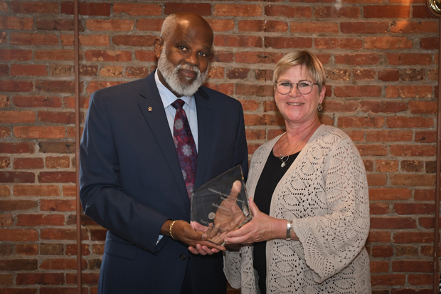 Maryland Legal Aid Executive Director Wilhelm H. Joseph, Jr., Esq., presents Donna Mattick, the chief investor relations officer with Soles4Souls, with a Partners for Justice Award during the 21st annual Equal Justice Awards Breakfast. (Photo by Eric Stocklin)