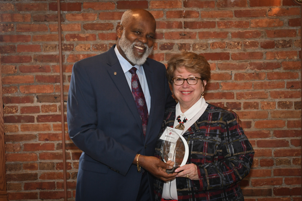 Maryland Legal Aid Executive Director Wilhelm H. Joseph, Jr., Esq., presents Del. Kathleen M. Dumais, D-Montgomery with the Champion of Justice Award during the 21st annual Equal Justice Awards Breakfast. (Photo by Eric Stocklin)