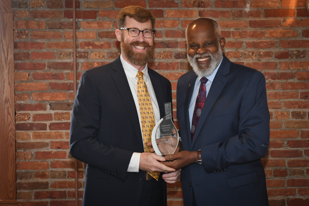 Judge Brett R. Wilson, left, an associate judge in the Washington County Circuit Court, receives the Champion of Justice Award from Maryland Legal Aid Executive Director Wilhelm H. Joseph Jr., Esq. during the 21st annual Equal Justice Awards Breakfast. (Photo by Eric Stocklin)