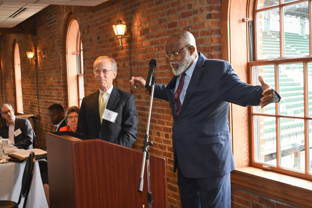 Legal Aid Executive Director Wilhelm H. Joseph Jr., Esq. speaks to the guests at the 21st annual Equal Justice Awards Breakfast before presenting The Executive Director's Award to Lee Ogburn, a principal with Kramon & Graham P.A. (Photo by Eric Stocklin)