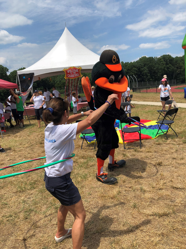 The Oriole Bird stopped by to share in the fun during a hula-hoop competition at DLA Piper's Horizon Day Camp Carnival. (Photo courtesy of Horizon Day Camp staff)