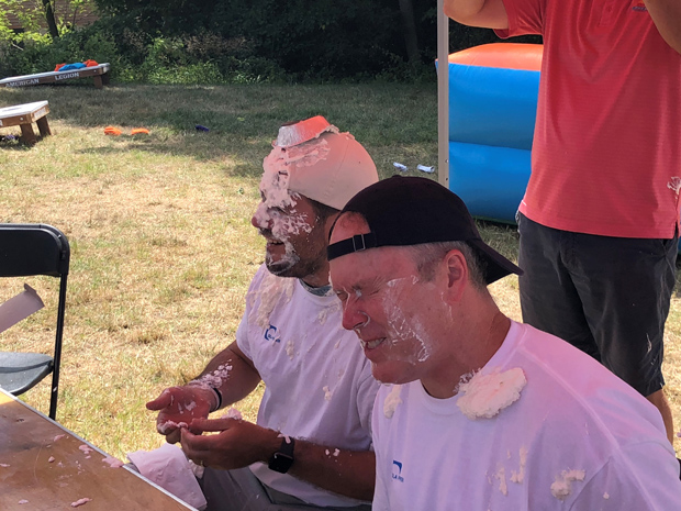Campers attending DLA Piper's Horizon Day Camp Carnival had fun throwing whipped cream pies at willing participants from DLA Piper's Baltimore office. (Photo courtesy of Horizon Day Camp staff)