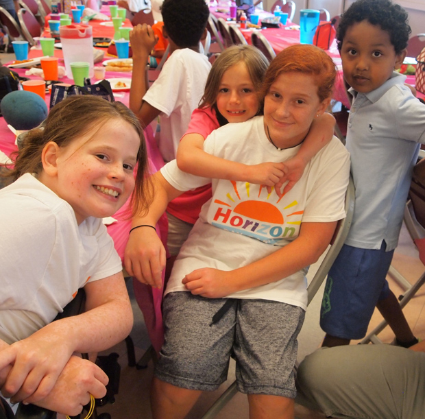 Campers and volunteers take a break from indoor activities to pose for a photo at the second annual Horizon Day Camp carnival. (Photo courtesy of Horizon Day Camp staff)