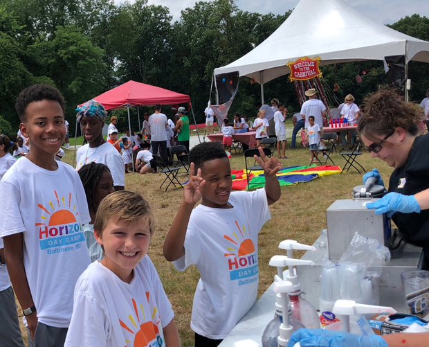 """Campers stand in line for """"frozen ice"""" at the second annual Horizon Day Camp carnival hosted by DLA Piper. (Photo courtesy of Horizon Day Camp staff)"""