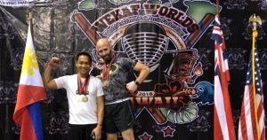 Mitchell Greenberg, right, poses with a fellow competitor at the WEKAF World Championships in Hawaii in July. (Courtesy of Mitchell Greenberg)