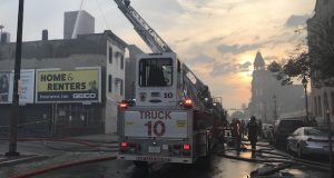 Baltimore firefighters fight blaze at Budeke's Paints in the 400 block of South Broadway in Fells Point on Friday morning. The historic business celebrated its 150th anniversary this year. (The Daily Record/Adam Bednar)