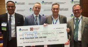 Remedy Plan Therapeutics won the start-up pitch contest at The Maryland Tech Council's Bio+Tech18. Pictured with a ceremonial check are, from left, Rene LaVigne, Maryland Tech Council board director; Greg Crimmins, CEO of Remedy Plan Therapeutics and Bio+Tech18 pitch contest winner; Jeff Galvin, CEO of American Gene and Bio+Tech18 pitch contest sponsor; and Bret Schreiber, senior director, Office of BioHealth and Life Sciences, Maryland Department of Commerce. (Submitted photo)