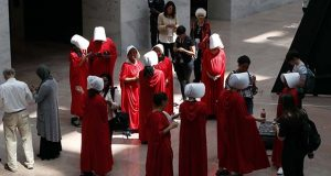 "Demonstrators protesting against Supreme Court nominee Brett Kavanaugh, wear costumes from the show ""The Handmaid's Tale,"" during his confirmation hearing with the Senate Judiciary Committee on Capitol Hill, Tuesday, Sept. 4, 2018, in Washington. (AP Photo/Jacquelyn Martin)"