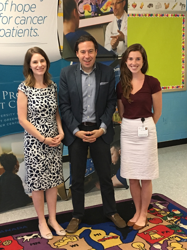 The Maryland Proton Treatment Center was instrumental in donating money to help renovate a kindergarten classroom at James McHenry Elementary School in west Baltimore. Representing the center at the celebration were, from left, Marketing Manager Allison Shafer, Vice President of Marketing Jeremy Steinberg and Griffin McMath, the program administrator of integrative wellness. (Photo by Annie Yeager, Maryland Proton Treatment Center)