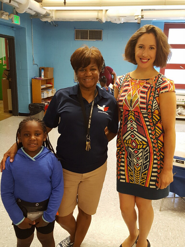 From left, kindergartner Paige Smith, James McHenry Elementary School Community School Coordinator Heidi Stevens and Maryland Proton Treatment Center Marketing Assistant Annie Yeager pose for photo during the celebration. (Photo by Annie Yeager, Maryland Proton Treatment Center)