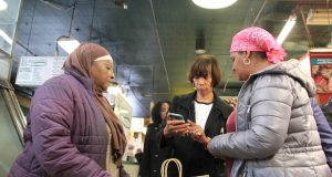Mayor Catherine Pugh talks with residents during a tour of Lexington Market on Wednesday. The mayor said some people she spoke with asked for help, but generally thanked her for the work being done to revive Lexington Market. (Adam Bednar)