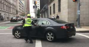 Still frame of video showing motorist driving away from traffic enforcement officer who ordered him to pull over. (The Daily Record/Adam Bednar)