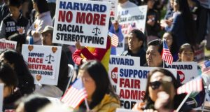 Demonstrators against Harvard University's admission process protest at Boston's Copley Square on Monday, when a student group's lawsuit against the university for discriminating against Asian-Americans in the admission process went to trial. However a federal judge rules, the case is likely to end up before the Supreme Court. (Bloomberg photo by Adam Glanzman)