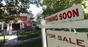 FILE- In this Aug. 30, 2018, file photo a sale signs stand outside a home on the market in Denver. On Friday, Oct. 19, the National Association of Realtors reports on sales of existing homes in September. (AP Photo/David Zalubowski, File)