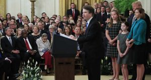 President Donald Trump, Chief Justice John Roberts, back left, and justices of the Supreme Court, listen to Justice Brett Kavanaugh speak during the ceremonial swearing-in ceremony of Kavanaugh as Associate Justice of the Supreme Court of the United States in the East Room of the White House in Washington, Monday, Oct. 8, 2018. Kavanaugh is accompanied by his wife Ashley Kavanaugh, third from left, and children Margaret, second from left, and Liza. (AP Photo/Manuel Balce Ceneta)