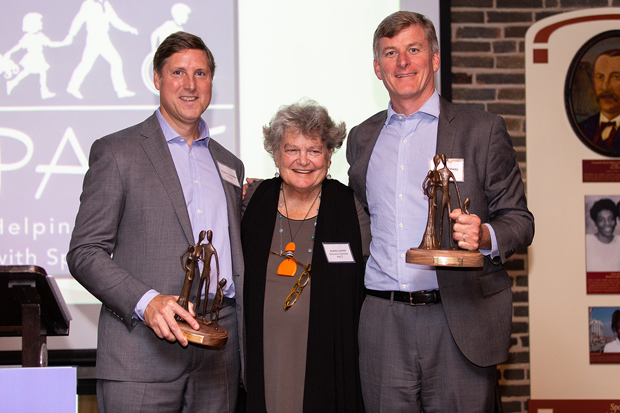 PACT Executive Director Audrey Leviton, LCSW-C, center, gets a photo with Audrey Leviton imPACT Award winners Charlie Constable, head of private client at Brown Advisory, and Tim Hathaway, head of U.S. institutional business with Brown Advisory. (Photo courtesy of PACT)