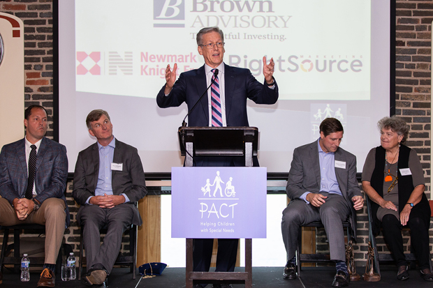 Hunter Lochte, a parent of a child who needed PACT's services, speaks to the audience during the benefit that helped raise $70,000 for PACT's specialized child care centers. (Photo courtesy of PACT)