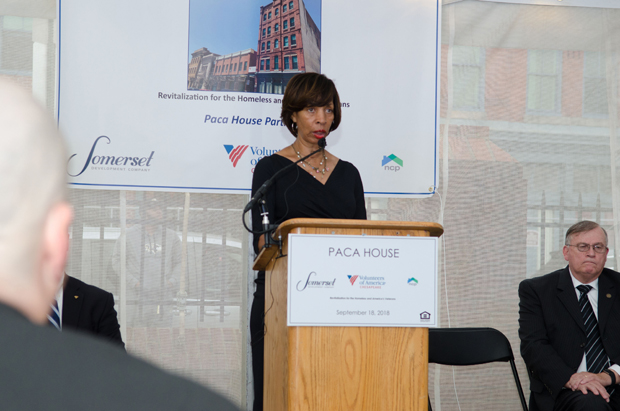 Baltimore Mayor Catherine Pugh speaks to guests at the Volunteer of America Chesapeake's Paca House groundbreaking ceremony, joined on stage by Robert Finn, Deputy Secretary of the Maryland Department of Veteran Affairs. (Photo by Jackson Clay, JKC Visuals)