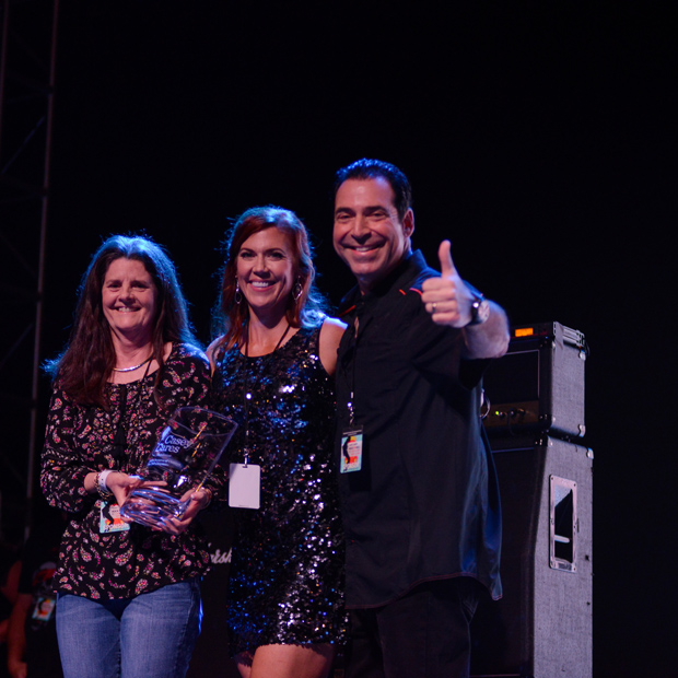 From left, Champion of Children honoree Mary Claire Goff receives her award from Casey Cares Founder Casey Baynes and Rock 'n' Roll Bash chair Mike DiMayo. (Photo by Carolina Francisca)