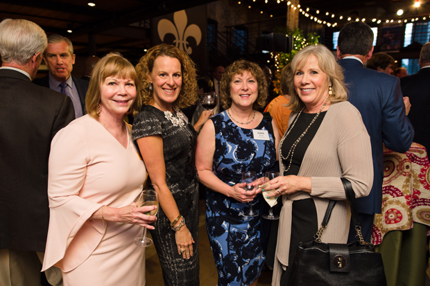 From left, Tere Geckle, chair of the board of directors at Marian House; Lori Villegas, a senior vice president and wealth adviser with Morgan Stanley; Judith Ward, a senior financial planner at T. Rowe Price; and Marianne Mattran, president and co-founder of Foundry Wealth Advisors LLC, enjoy the evening at the Winslow-Parker Metal Building in Baltimore. (Photo courtesy of United Way of Central Md.)