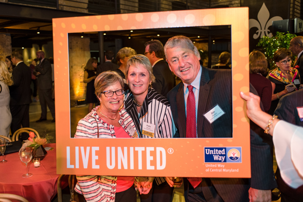 From left, Deborah Diehl, a partner with Whiteford Taylor Preston; Patty Brown, president of Johns Hopkins Healthcare LLC; and Jim Anders, executive vice president and chief operating officer of Kennedy Krieger Institute, have some fun with taking a photo during The United Way of Central Maryland's Tocqueville Society's annual event. (Photo courtesy of United Way of Central Md.)