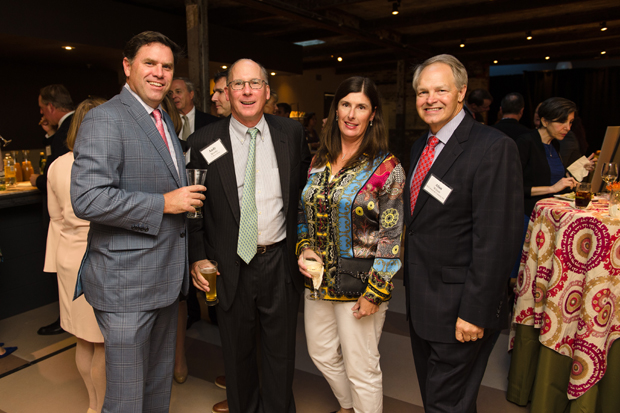 From left, Hugh Warns III, senior vice president and director of equity research with Stifel, Nicolaus & Company Inc., Andrew M. Brooks, vice president and head of U.S. equity trading with T. Rowe Price; Monica Warns; and Alan Wilson, president and CEO of McCormick & Co.., enjoy the evening at The Winslow-Parker Metal Building in Baltimore. (Photo courtesy of United Way of Central Md.)