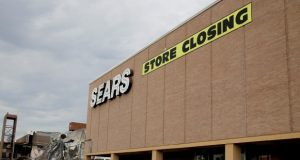 A Sears store slated for closing that is next to a mall that is being torn down in Overland Park, Kan., in July 2017. Sears has filed for Chapter 11 bankruptcy protection Monday, Oct. 15, 2018, buckling under its massive debt load and staggering losses. (AP Photo/Charlie Riedel, File)